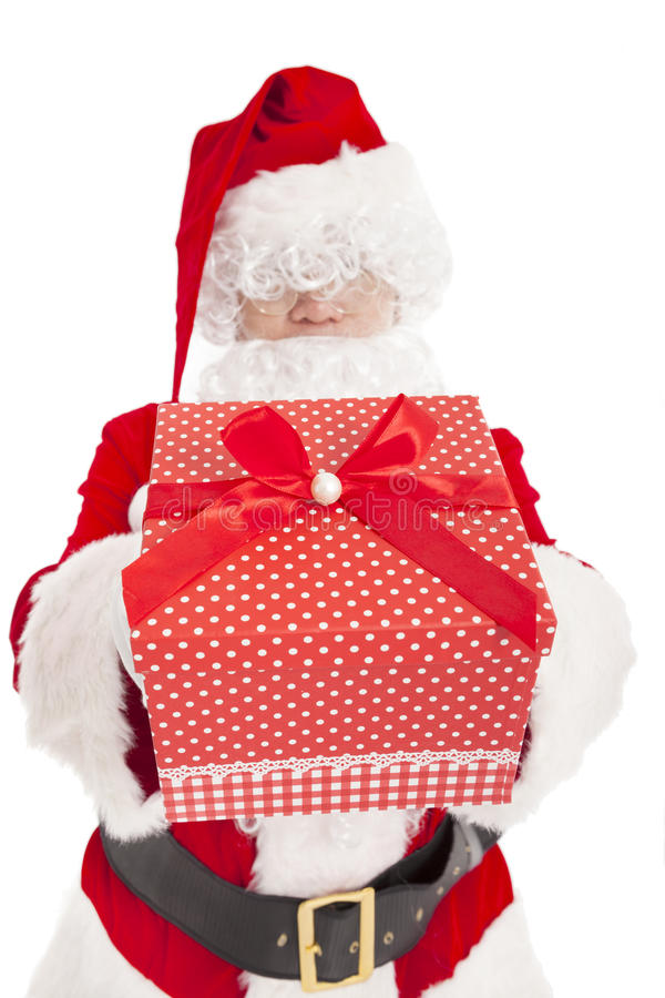 Santa claus showing gift box. Isolated stock photography