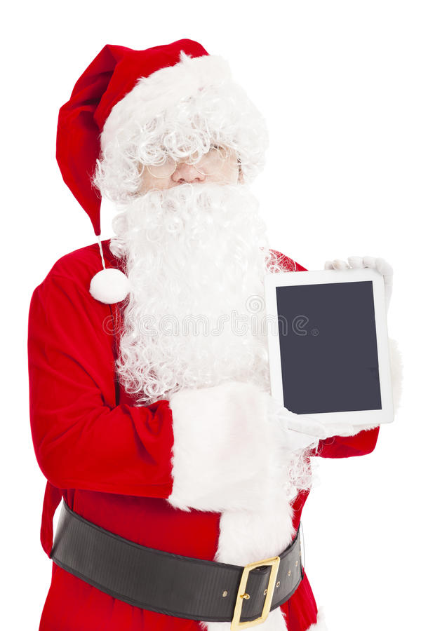Santa claus showing tablet pc. Isolated royalty free stock photography