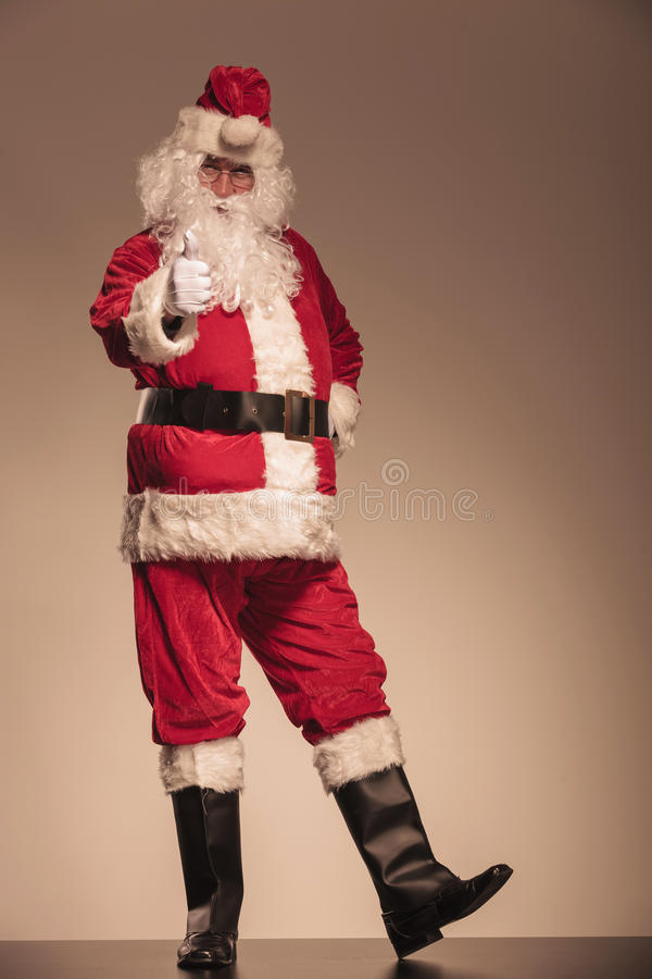 Santa Claus showing the thumbs up gesture royalty free stock photography