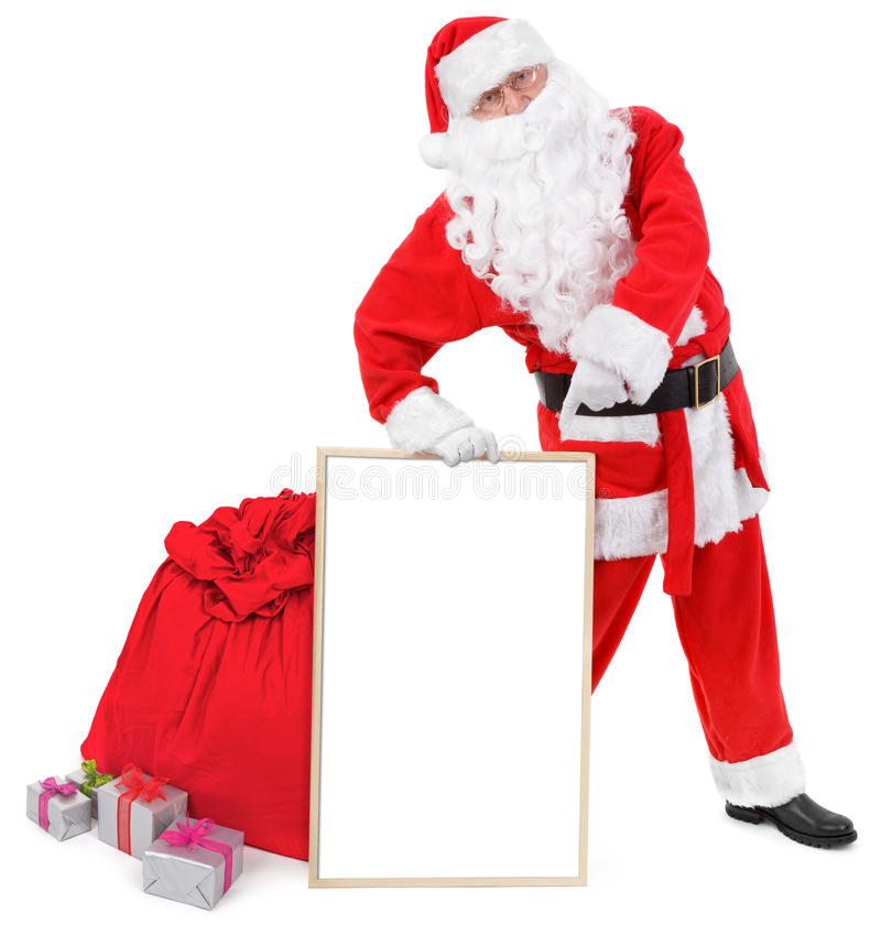 Santa claus shows blank white board stock photos