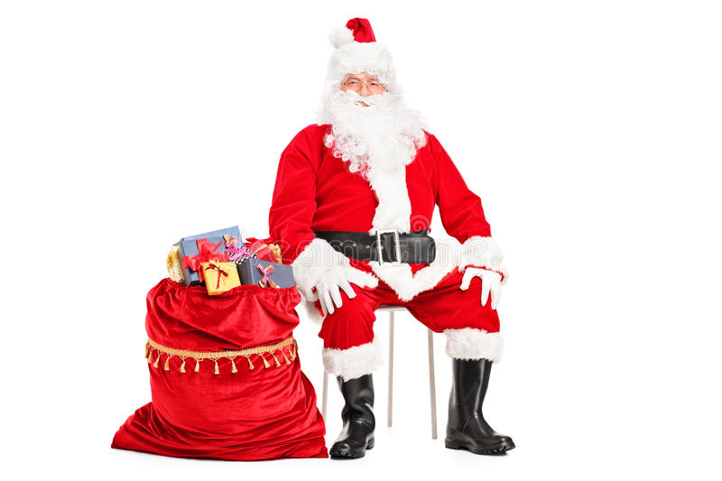 Download Santa Claus Sitting With Bag Full Of Presents Stock Image - Image of shot, chair: 27471607