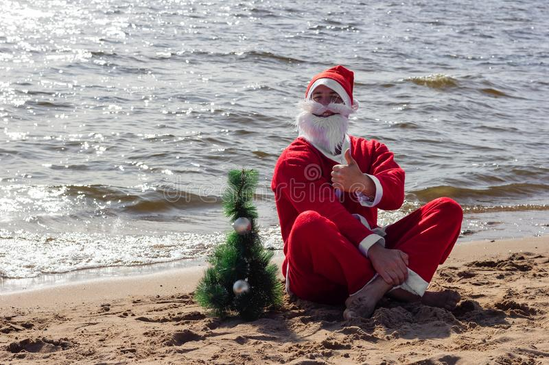 Santa claus is sitting on the beach  welcomes celebration christmas new year royalty free stock images