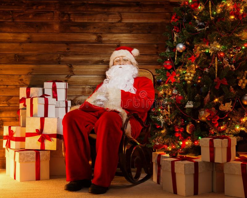 Santa claus sitting on rocking chair stock images image