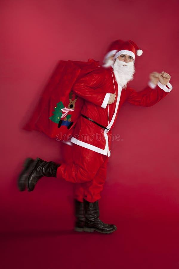 Santa Claus ska bråttom leverera gåvor arkivbilder