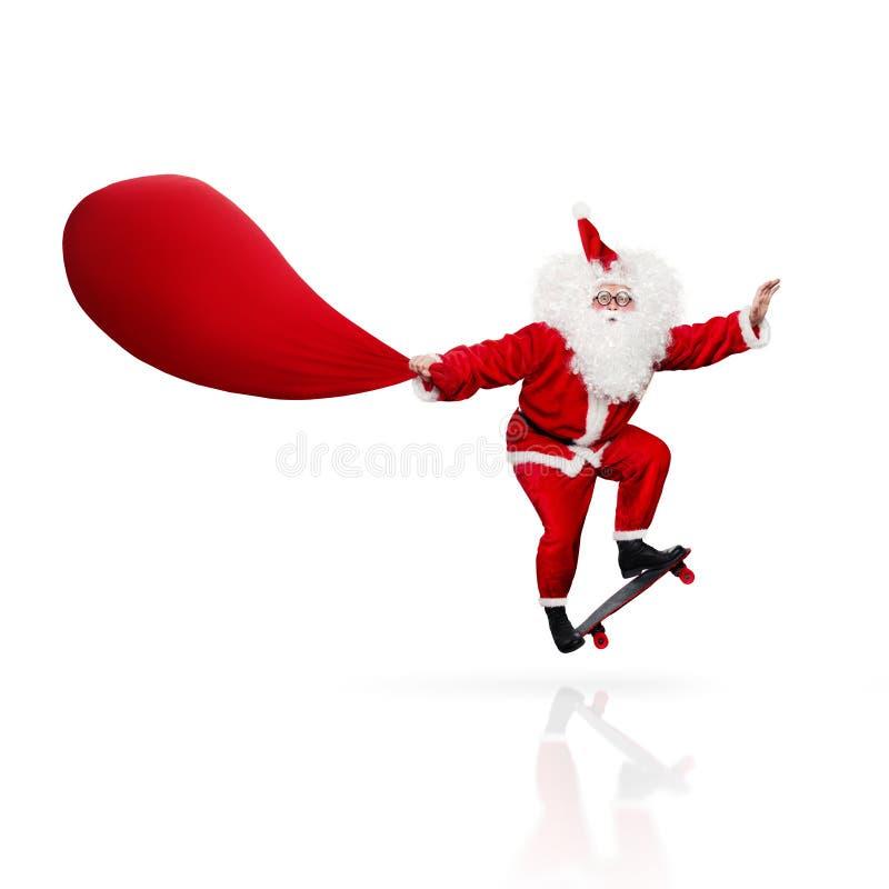 Santa Claus skateboarding isolated on white stock photos