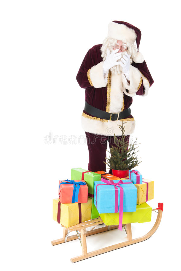 Santa Claus and sled with many Chirstmas presents. Sled with many colorful Christmas presents and tree pulled by Santa Claus isolated overwhite background stock photo