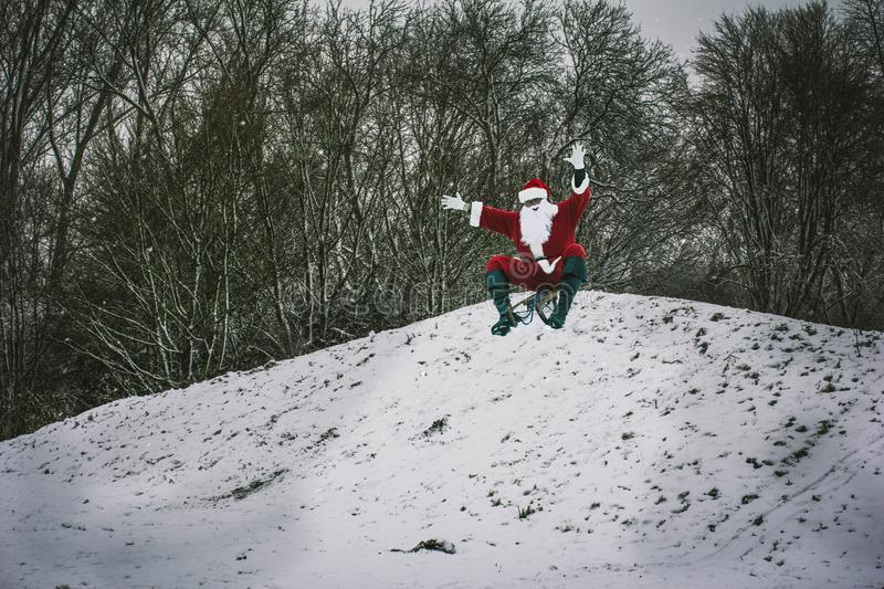 Santa Claus sledging in a snow-covered winter park. Santa Claus royalty free stock photos