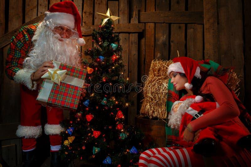 Santa Claus With Sleeping Woman Stock Photo