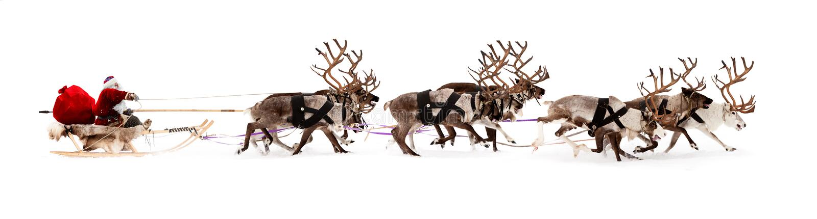 Santa Claus in a sleigh. Santa Claus rides in a reindeer sleigh. He hastens to give gifts before Christmas stock image