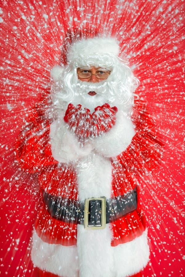 Santa Claus snow blow stock images