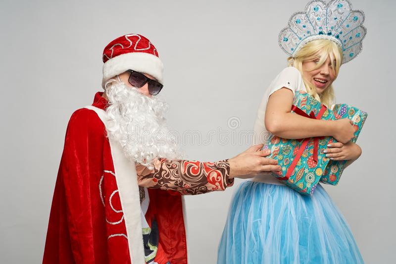 Santa Claus and snow maiden, thanksgiving, Christmas and New year, red yellow blue balls stock photos