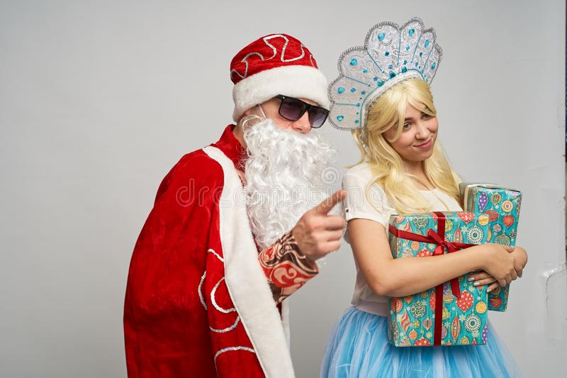 Santa Claus and snow maiden, thanksgiving, Christmas and New year, red yellow blue balls royalty free stock images