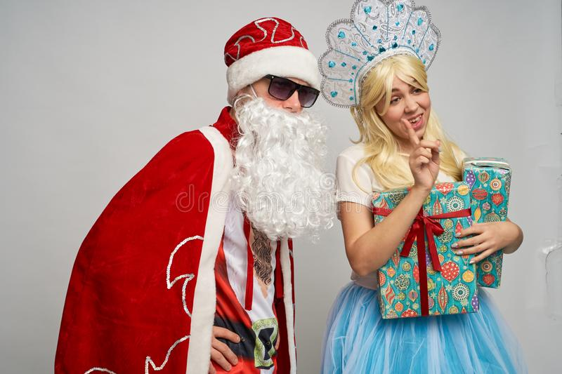 Santa Claus and snow maiden, thanksgiving, Christmas and New year, red yellow blue balls stock photo