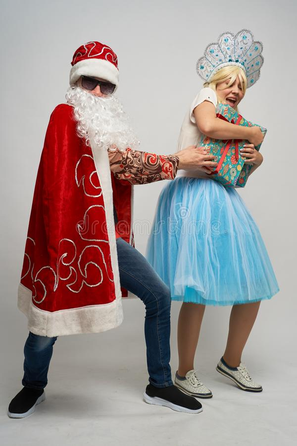 Santa Claus and snow maiden, thanksgiving, Christmas and New year, red yellow blue balls royalty free stock photography