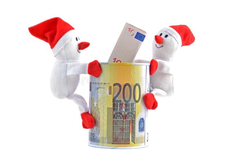 Santa Claus - snowman and money stock photo