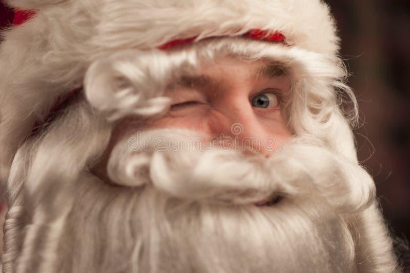 Santa Claus som blinkar på dig royaltyfria bilder