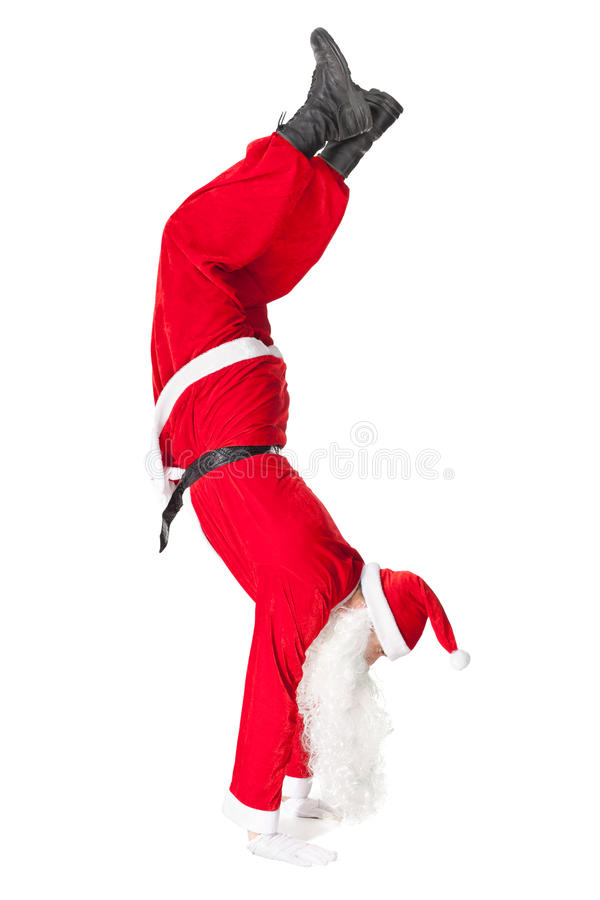 Santa Claus standing head over feet royalty free stock image