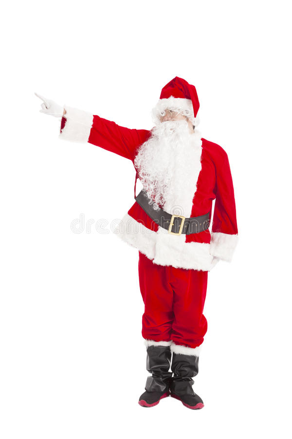 Santa Claus standing and pointing. Merry Christmas Santa Claus standing and pointing stock image