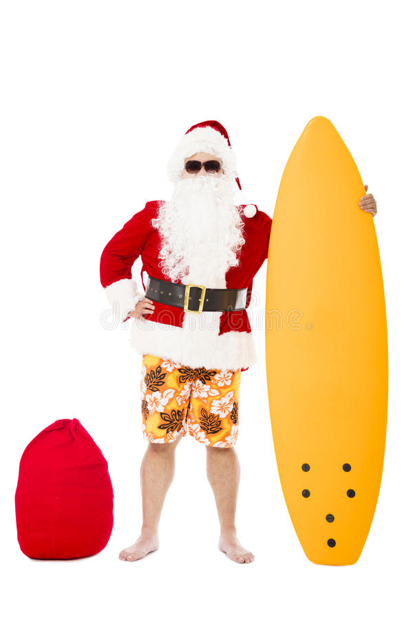 Santa Claus standing with surf board royalty free stock photos