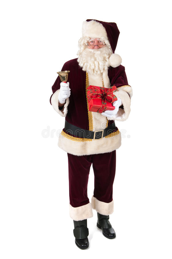 Santa Claus in studio. The real Santa Claus with bell and luxury present royalty free stock images