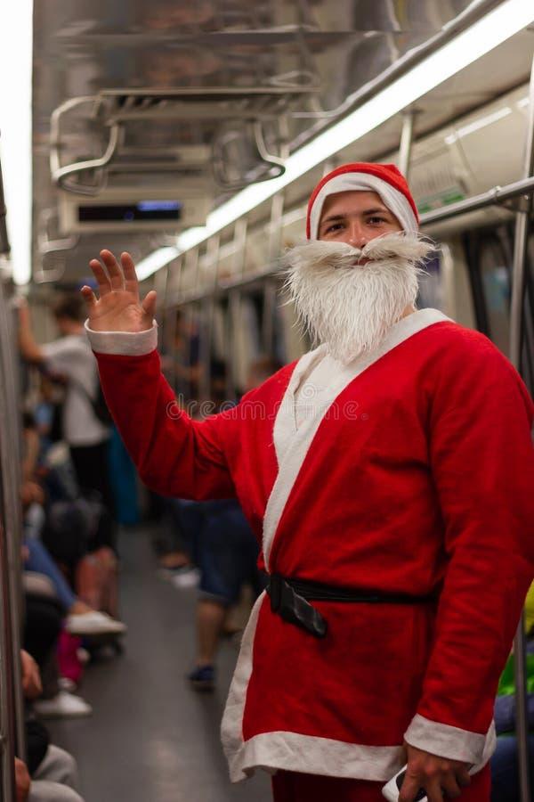 Santa claus subway goes to work metro  transport  train stock photos
