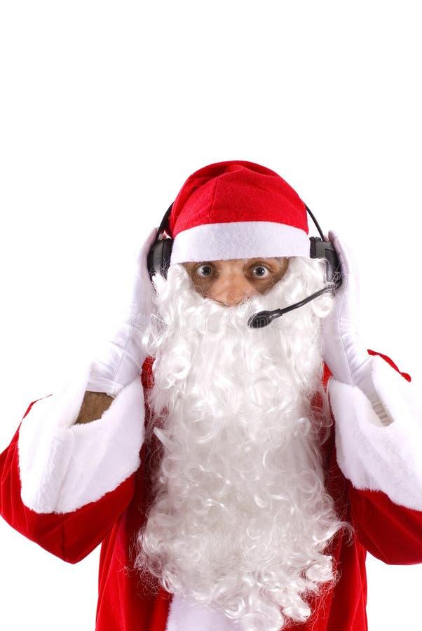 Santa Claus Telemarketing Suport. Santa Claus working as Telemarketing employee royalty free stock photo