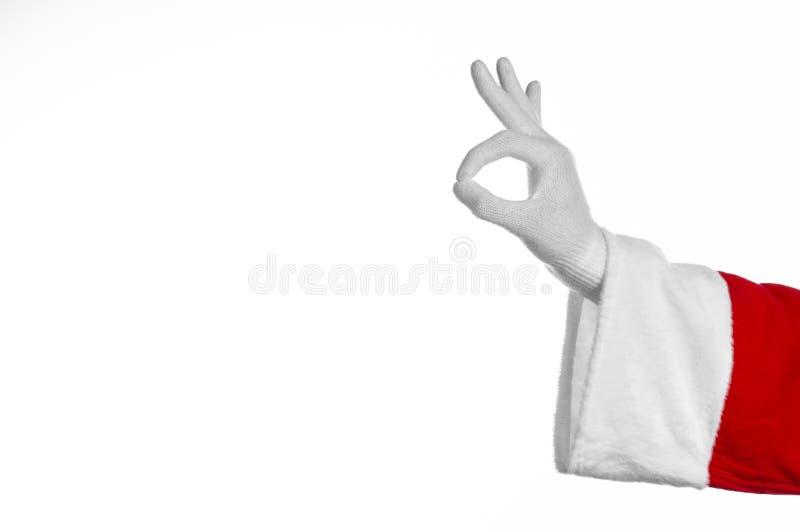 Santa Claus-thema: De hand die van de kerstman gebaar op een witte achtergrond tonen stock foto's