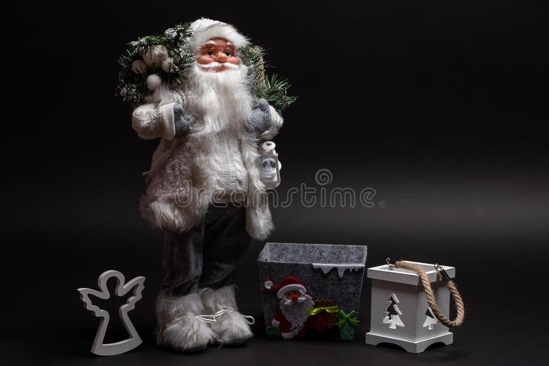 Santa Claus toy with wooden angel, crafted box and candle holder. Christmas home design stock photography