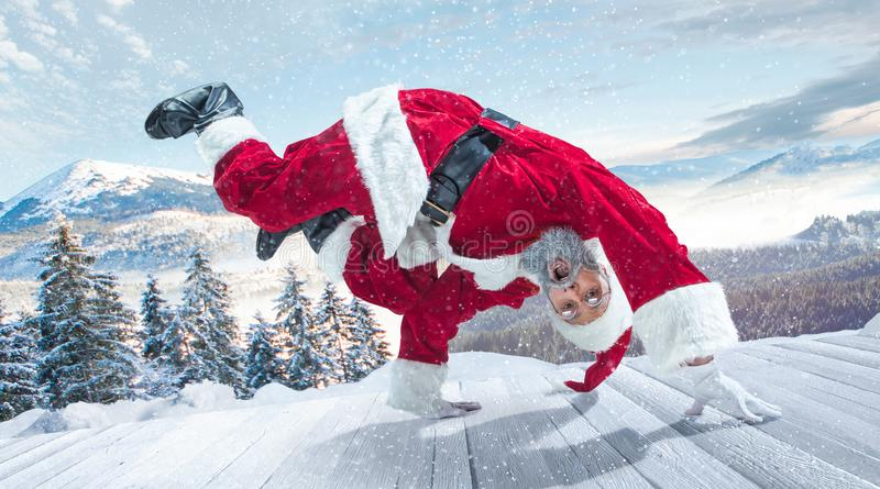 Santa Claus with traditional red white costume in front of white snow winter landscape panorama royalty free stock photography