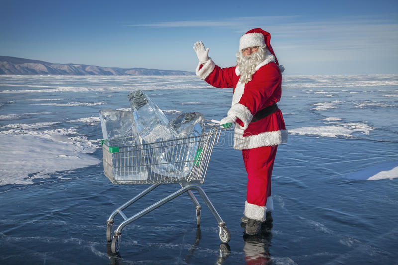 Santa Claus with a trolley of pure ice at winter Baikal lake royalty free stock photo