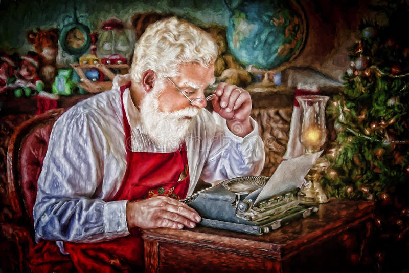 Santa Claus with Typewriter in Workshop royalty free stock images