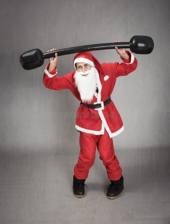 Santa Claus in un momento di forma fisica fotografia stock libera da diritti