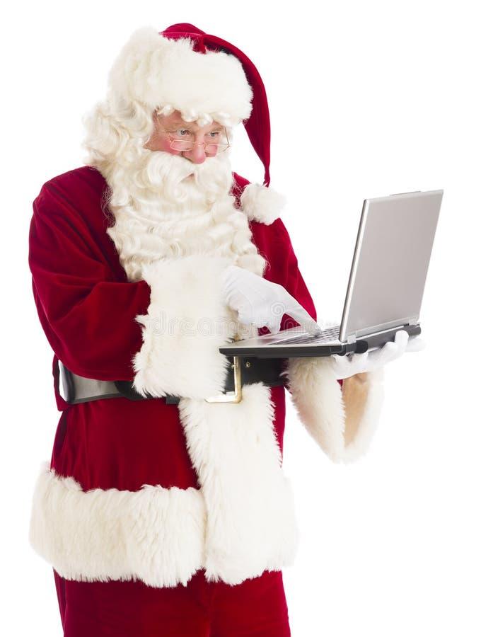 Santa Claus Using Laptop fotos de stock royalty free