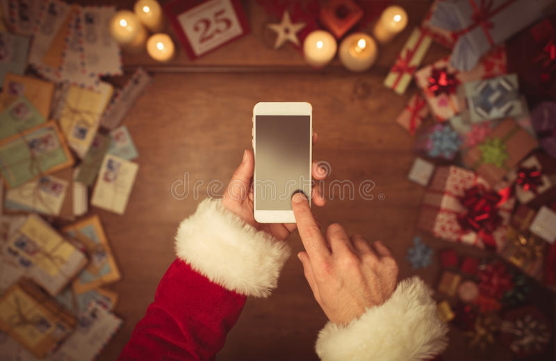 Download Santa Claus Using A Smart Phone Stock Photo - Image of festive, claus: 62589670