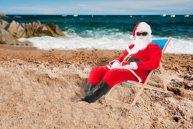 Santa Claus on vacation. Santa Claus in beach chair on vacation isolated over white background stock image
