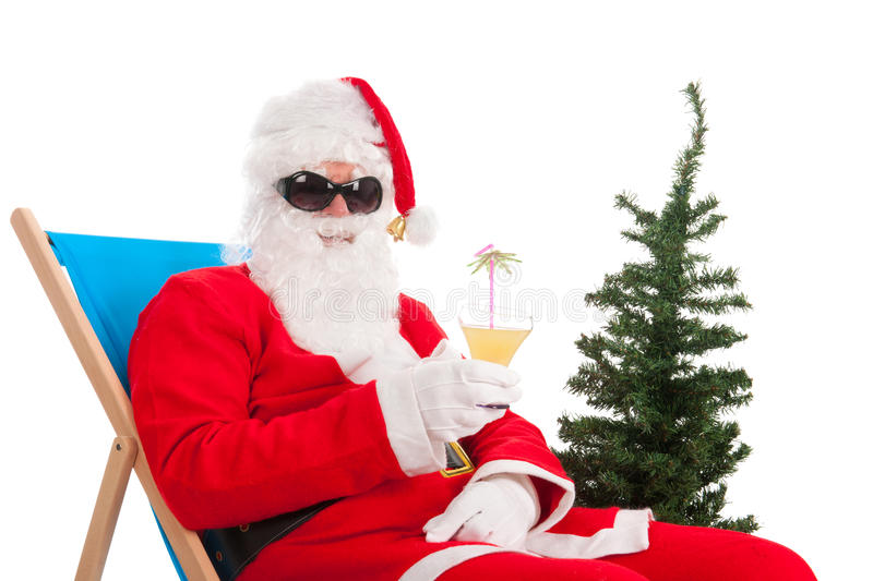 Santa Claus on vacation. Santa Claus in beach chair on vacation isolated over white background stock images