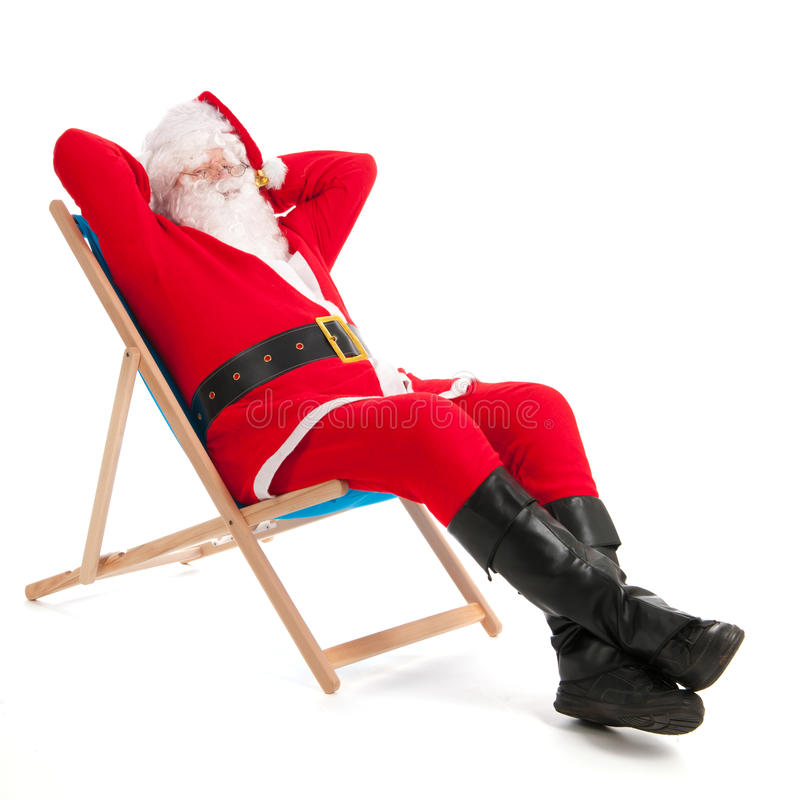 Santa Claus on vacation. Santa Claus in beach chair on vacation isolated over white background royalty free stock photo