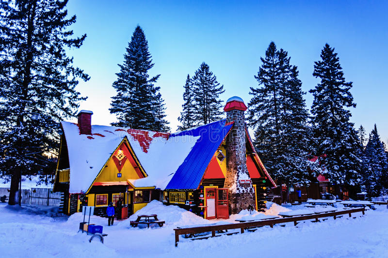 Santa Claus` Village, Val-David, Quebec, Canada - January 1, 2017: Big house in Santa Claus village. Winter. Nice place to spend winter holidays active royalty free stock images