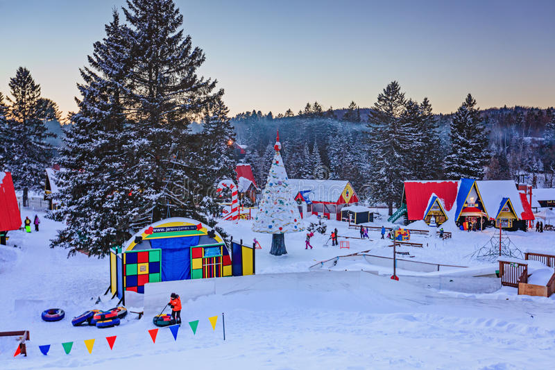 Santa Claus` Village, Val-David, Quebec, Canada - January 1, 2017. Santa Claus village, early evening in winter. Nice place to spend winter holidays active stock photography