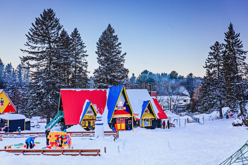 Santa Claus` Village, Val-David, Quebec, Canada - January 1, 2017: House in Santa Claus village. In winter. Nice place to spend winter holidays active. Early royalty free stock images
