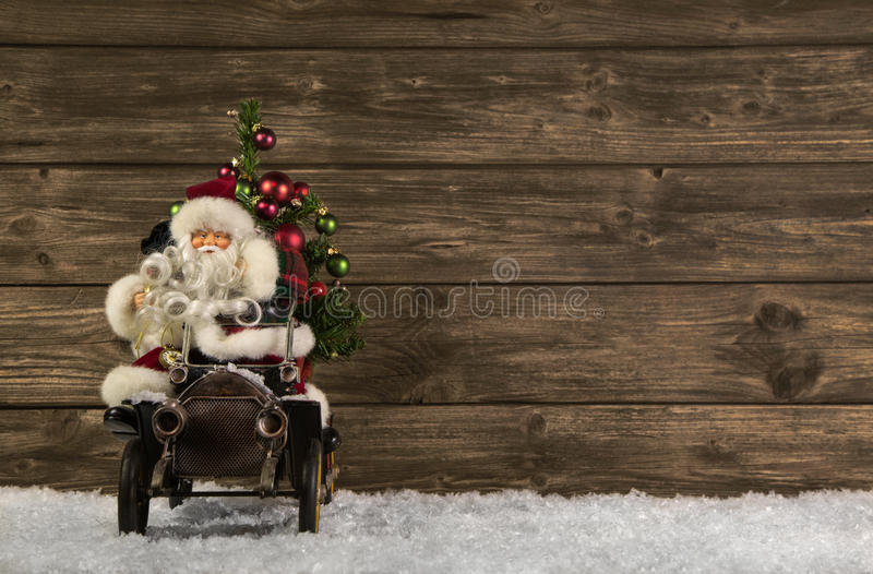 Santa Claus: Vintage christmas decoration on wooden brown background in vintage look. Santa Claus: Vintage christmas decoration on wooden brown background stock photography