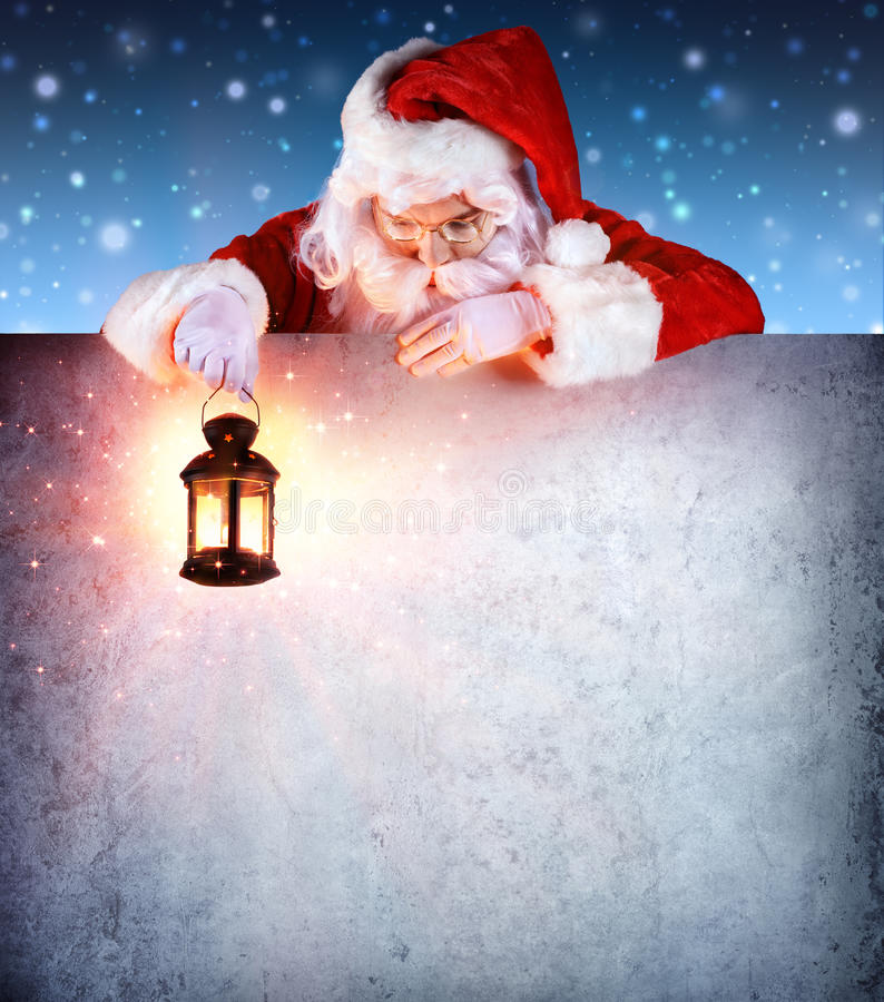 Santa Claus On Vintage Signboard. With Lantern royalty free stock photo