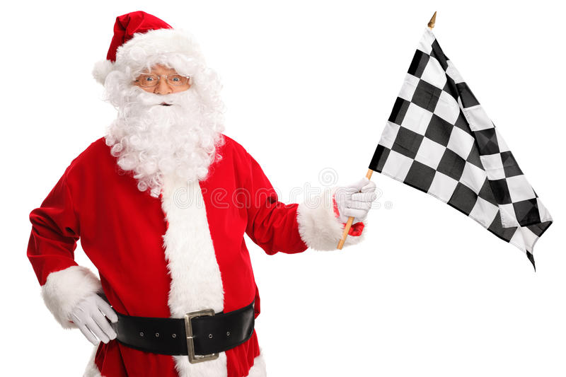 Santa Claus waving a racing flag. Santa Claus waving a checkered racing flag and looking at the camera isolated on white background royalty free stock photos