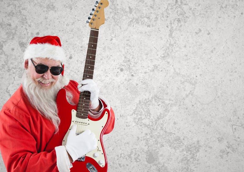 Santa claus wearing sunglasses playing guitar stock photo