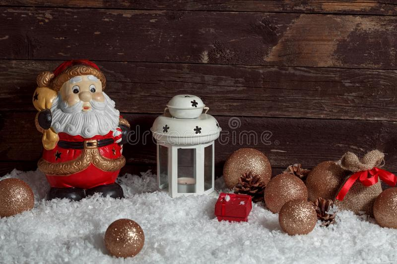Santa Claus white candle lantern on snow Christmas decoration stock images