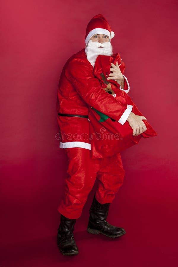 Santa Claus wil alle giften zelf nemen royalty-vrije stock foto