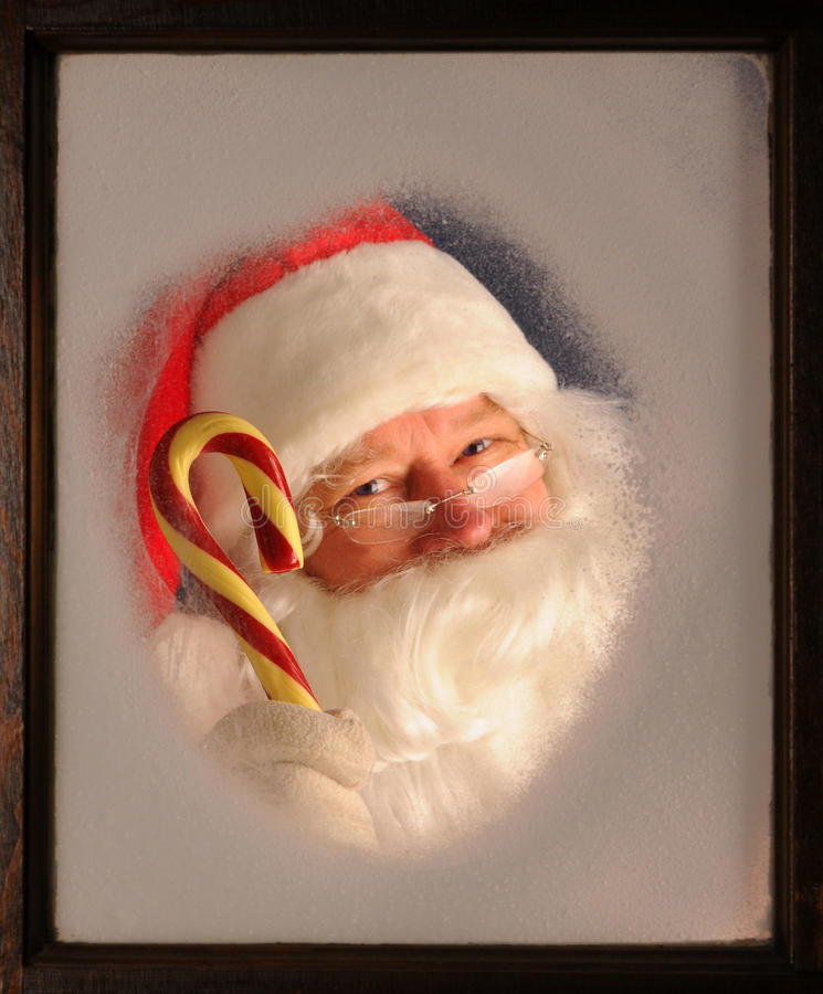 Download Santa Claus In Window With Candy Cane Royalty Free Stock Image - Image: 17024016