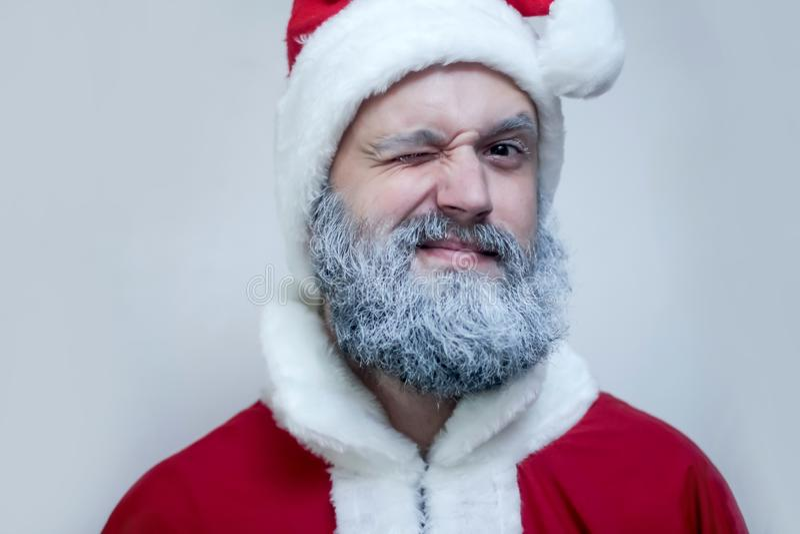 Santa Claus winks stock photography