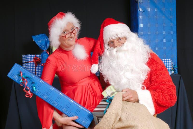 Santa Claus and woman stock image