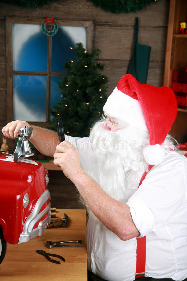 Santa Claus at work. Making toys in his workshop in the north pole royalty free stock photos